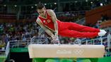 Российский гимнаст Давид Беявский во время упражнений на коне