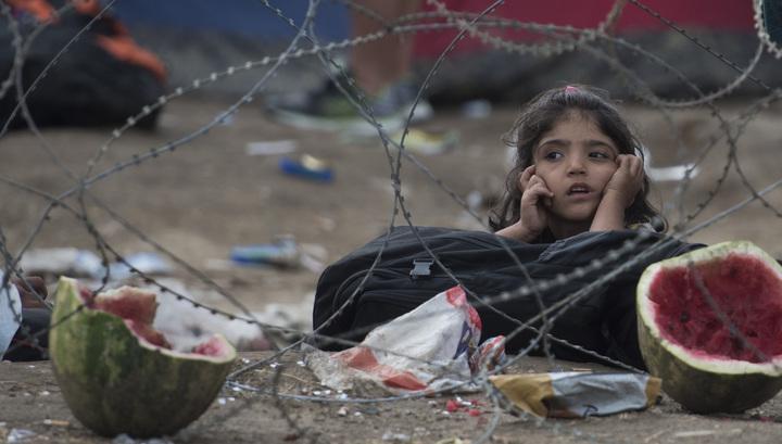 Немецкий министр: Поток беженцев может достичь 100 миллионов человек