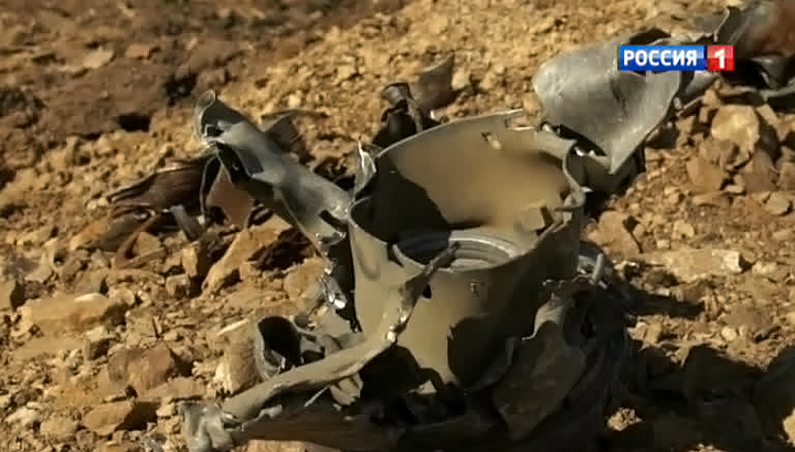 """Окровавленные вещи пассажиров """"Боинга"""" лежат в воронках от украинских снарядов"""