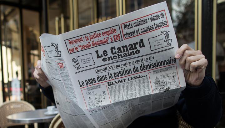 Журналистов французской Canard enchaine пообещали изрубить топором