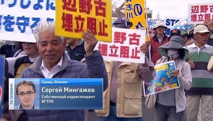 Японцы защищают коралловые рифы от американцев живой цепью
