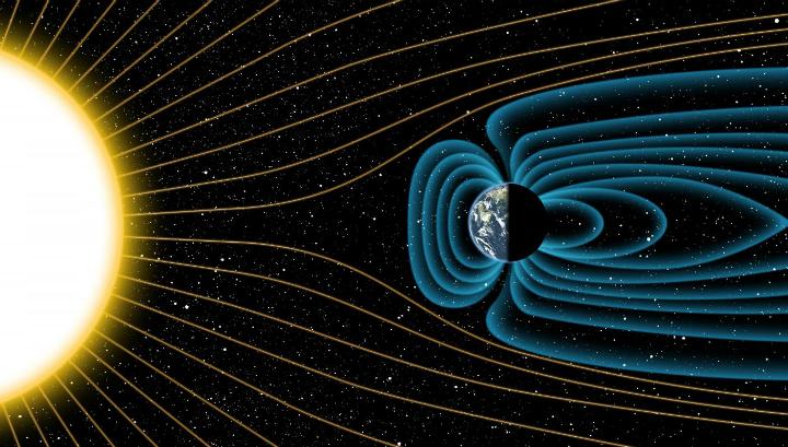 Так в представлении художника древнейшее магнитное поле отражало мощные солнечные ветра миллиарды лет тому назад
