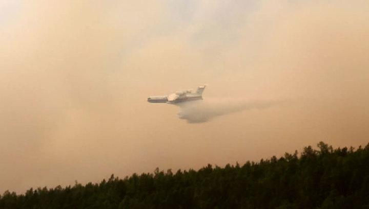 Армейская авиация продолжает помогать в тушении лесных пожаров Сибири