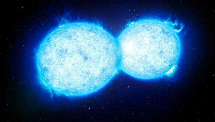 Двойная система VFTS 352 в туманности Тарантул, обнаруженная астрономами ЕКА. Она состоит из двух очень горячих, ярких и массивных звёзд, которым предсказывают либо слияние, либо взрыв в виде сверхновых.