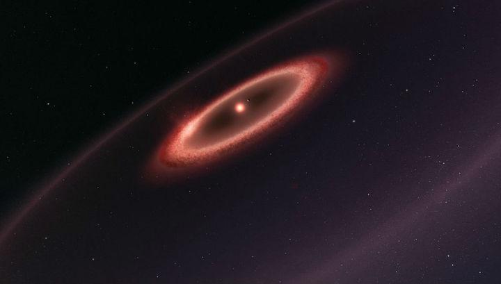 Холодные пылевые пояса вокруг звезды Проксима Центавра в представлении художника.