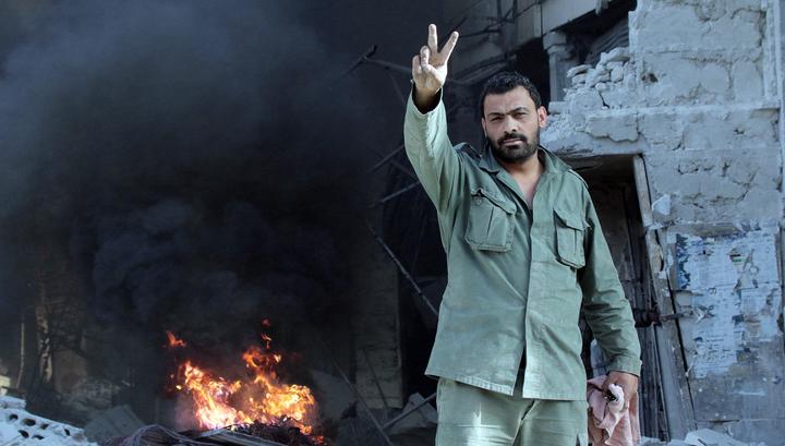 Исламские боевики на юго-западе Сирии продолжают сдавать оружие
