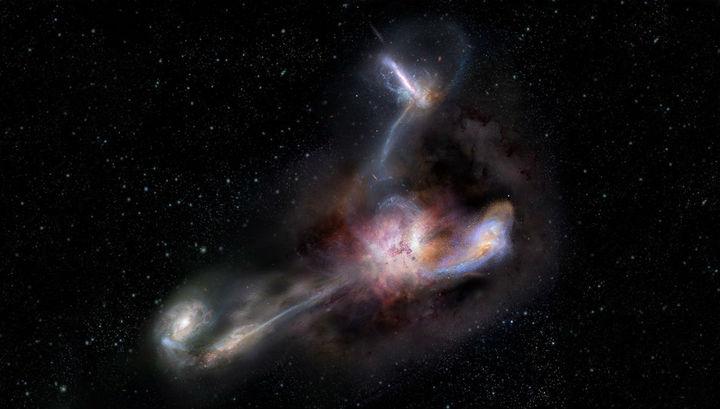 Самая яркая галактика поедает сразу трёх соседей