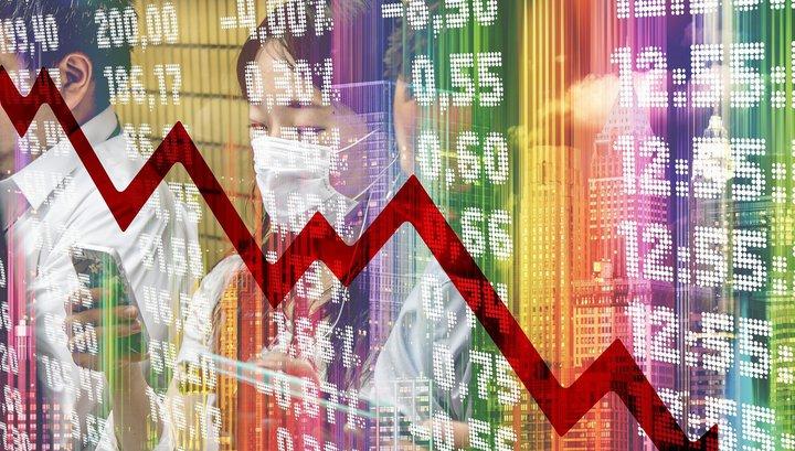 Рубль снизился к доллару и евро на старте торгов