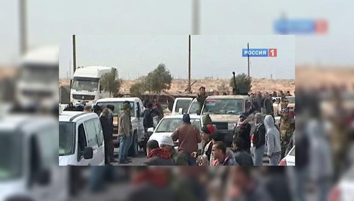 Каддафи забрасывает повстанцев бомбами и SMS