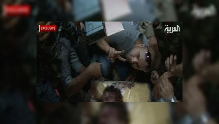 """Первые шаги """"молодой демократии"""": Каддафи не дожил до суда"""