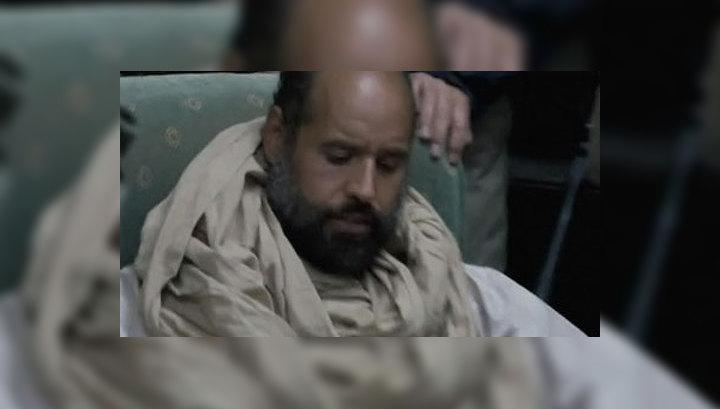 Сына Каддафи будут судить на родине