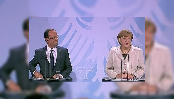 Молния не помешала Олланду встретиться с Ангелой Меркель