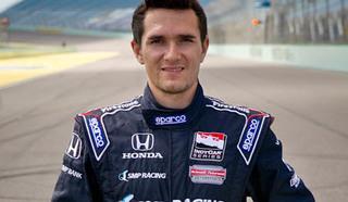 Российский автогонщик, пилот американской гоночной серии IndyCar Михаил Петрович Алёшин.