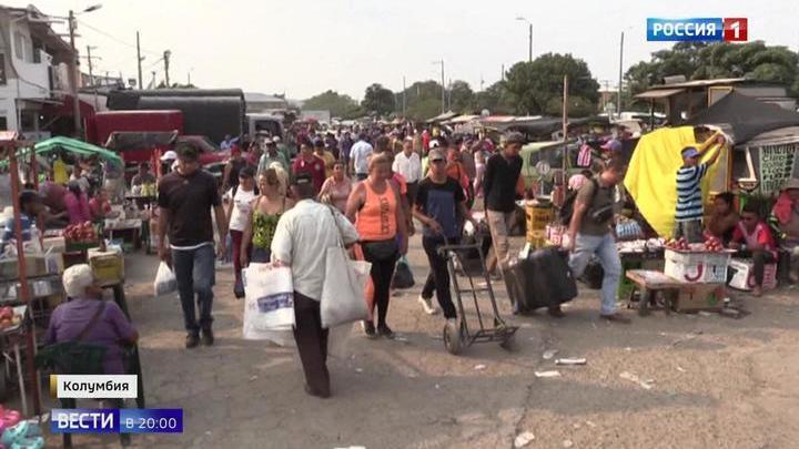 """Венесуэльские """"беженцы"""" закупаются в Колумбии и возвращаются обратно"""