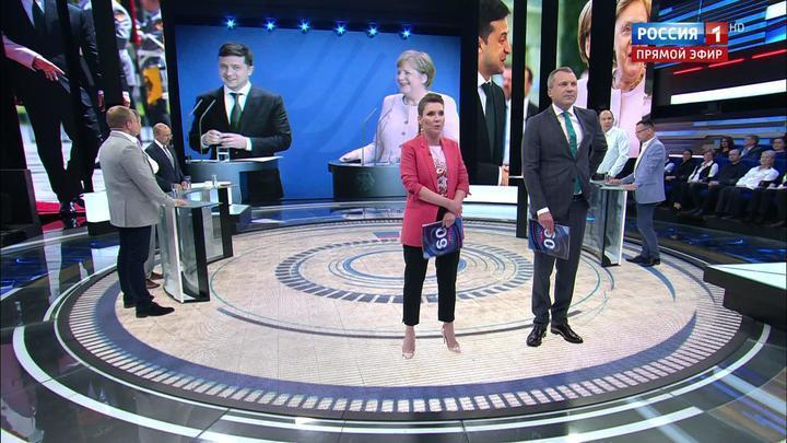 60 минут. Меркель задрожала при звуках гимна