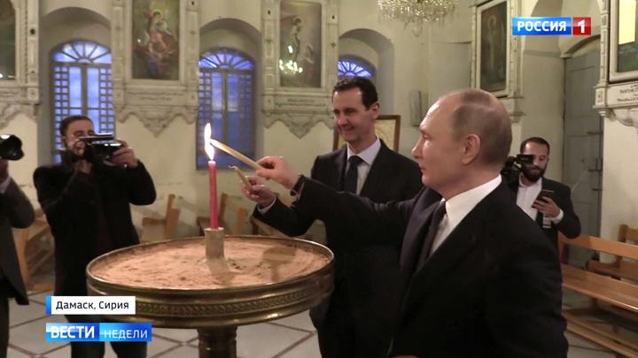 Путин и Асад поставили свечки за мир