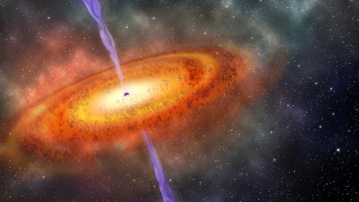 Из окрестностей чёрной дыры бьёт невероятно длинная струя.