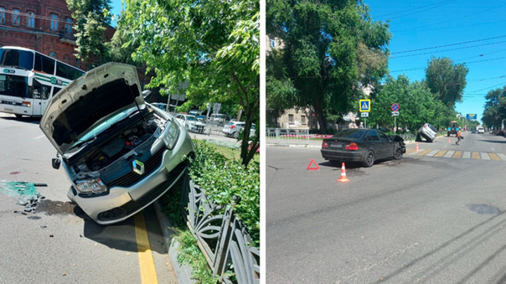 В Воронеже после ДТП иномарка повисла на заборе: пострадали двое
